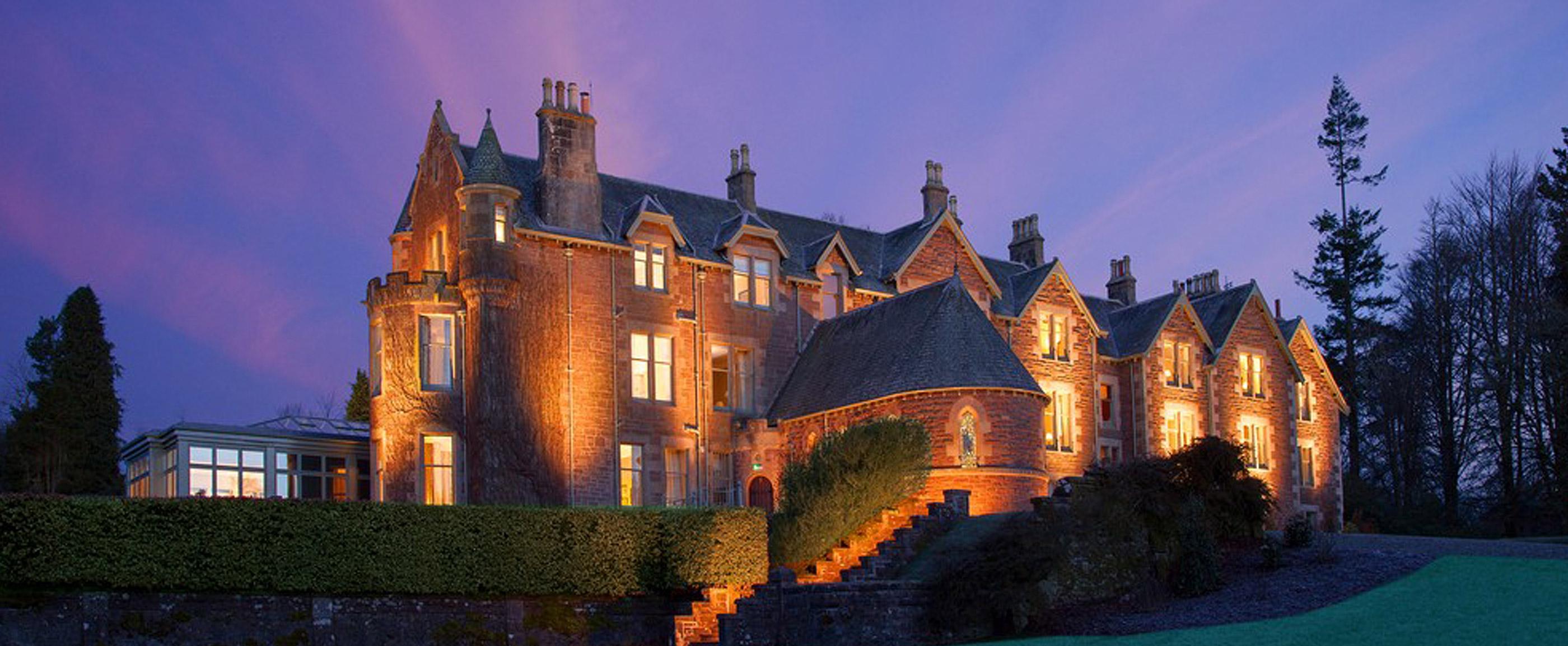 Photo of Cromlix House Hotel illuminated at dusk