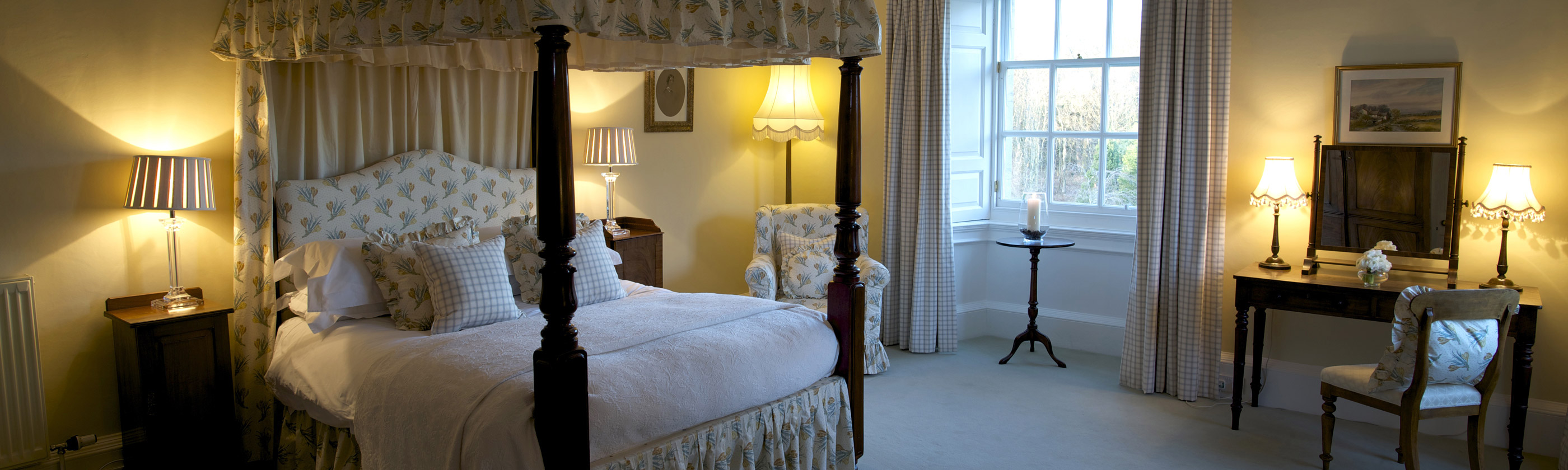 Photo of luxurious bedroom in Gilmerton House with four poster bed.