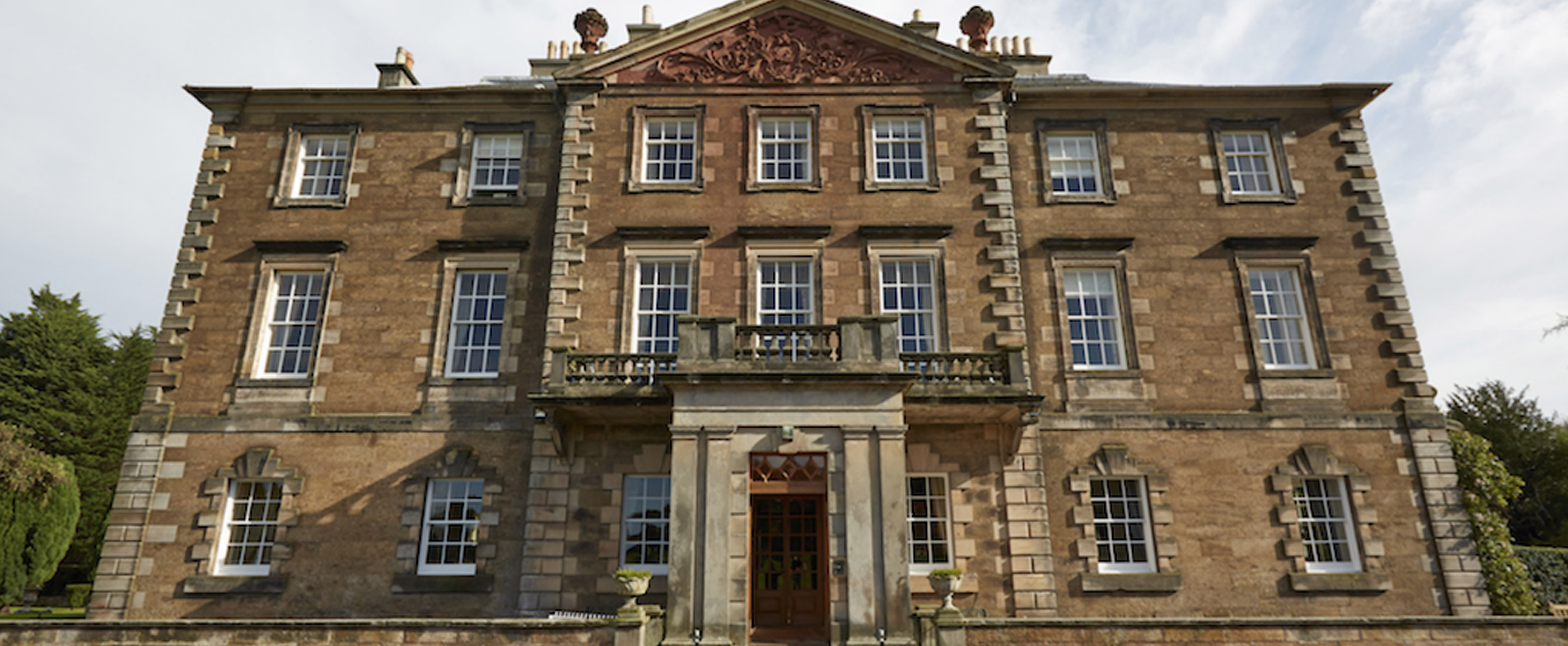 Photo of the exterior of Gilmerton House in East Lothian.