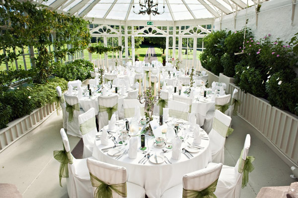 Photo of the light and bright conservatory at the Roxburghe Hotel dressed for a wedding reception