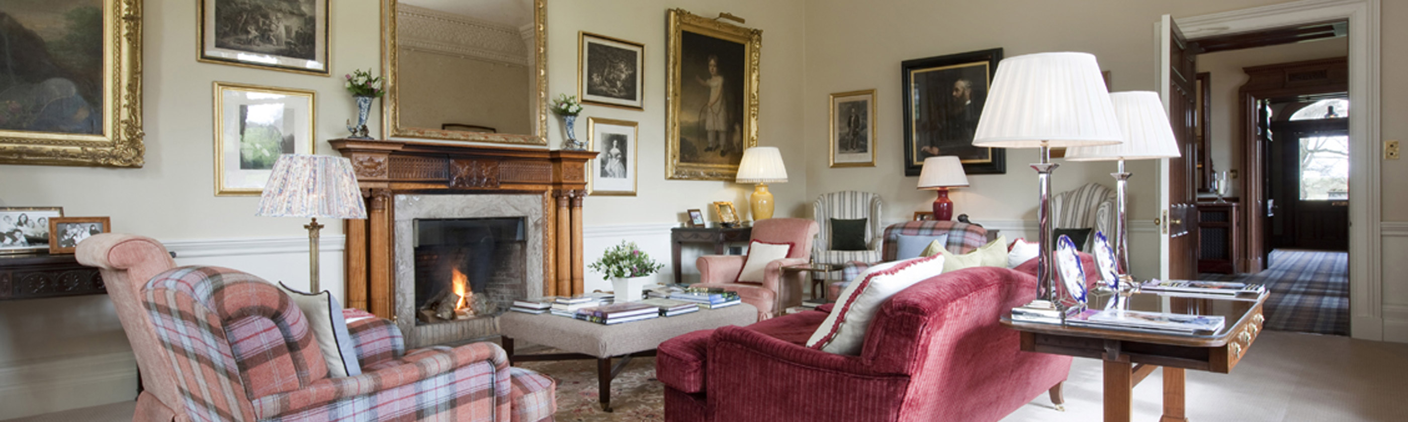 Photo of the drawing room with open fire in the Roxburghe Hotel