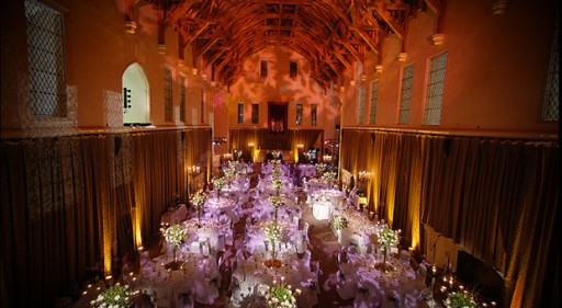 Photo of grand hall with vaulted ceiling set up for a wedding reception
