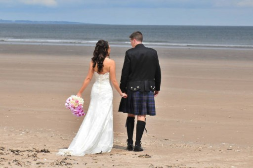 Photo of a bride and groom on the West Sands at St Andrews
