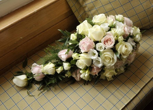 Photo of wedding bouquet with pale ivory, pink and white flowers